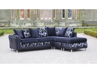 Large black corner sofa suite in faux leather chenille & pattern fabric